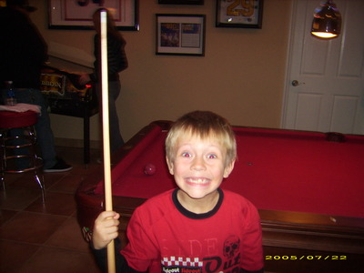 me at my moms bosses masion and playing pool when i was 6